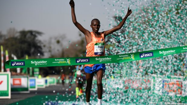 Kenya's Paul Lonyangata celebrates as he places first in the Men's Group during the 42nd edition of the Paris Marathon on April 8, 2018 in Paris. / AFP PHOTO / Eric FEFERBERG