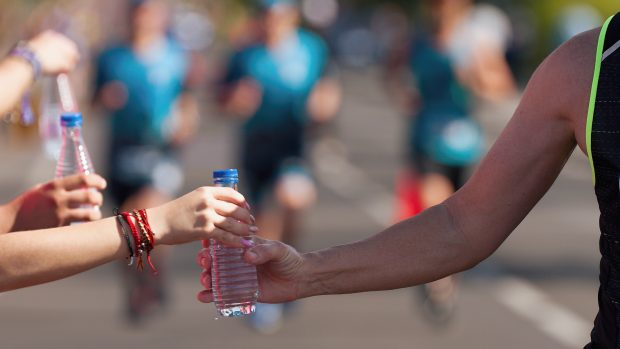 Drinks station at a running marathon, hydration drinking during a race