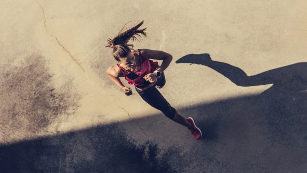 Women running in to the shadow
